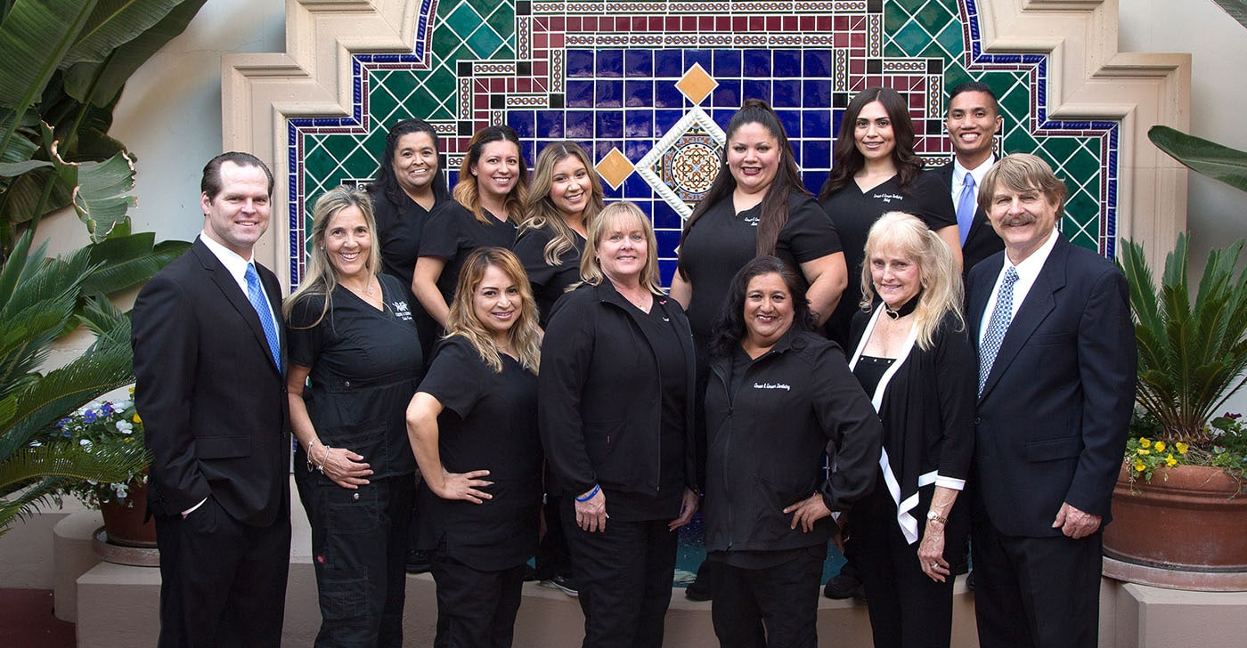 Oxnard dental team in front of office fountain