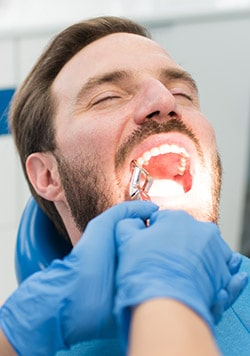 Patient sedated for tooth extraction.