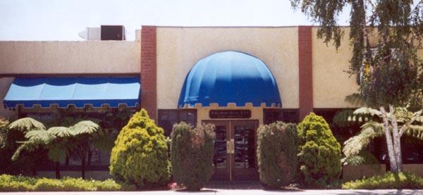 Characteristic blue awnings of the Carson & Carson DDS office in Oxnard