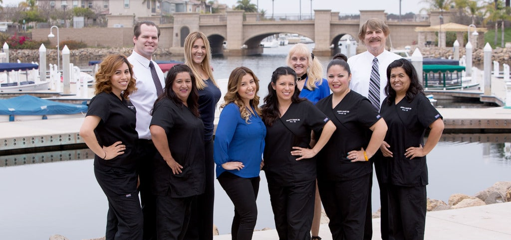 Our dental staff with marina background